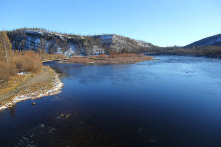 Chulman River in South Yakutia in autumn in clear weather photo