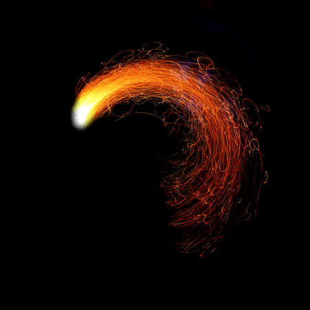 light red: sheaf of orange sparks on a black background