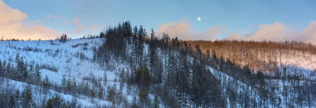 evening winter landscape in the mountains of the moon and clouds photo