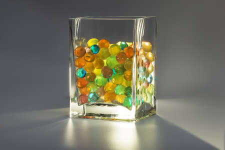 misted: misted glass with colored gel balls backlit on grey background