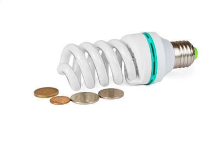 vitreous: Energy saving lamp and coin on a white background isolated