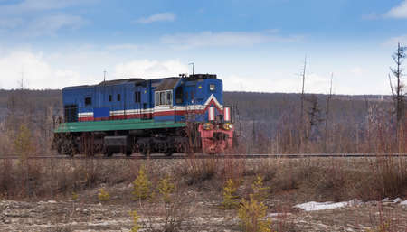 diesel locomotives: Blue locomotive on the railroad in South Yakutia, Russia Stock Photo