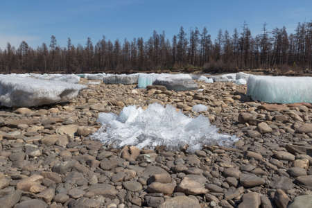 ice floes: Ice floes and ice crystals on the pebbly shore Stock Photo