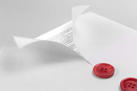 curled edges: document under a blank sheet of paper with curled edges and buttons Stock Photo