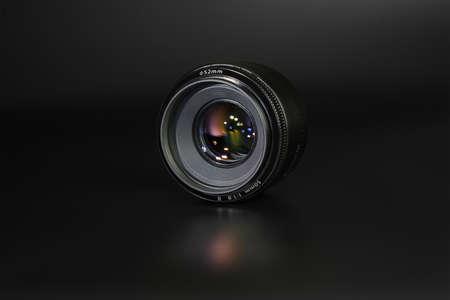 lens 50mm  1.8 black on a dark background