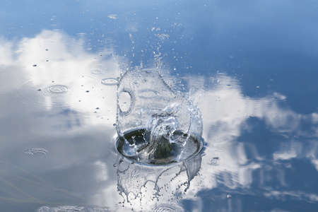 Splash from a stone thrown into the water