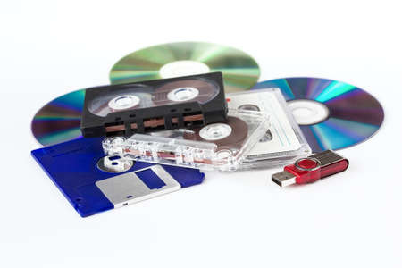 Various media - USB flash drive, CD-ROM, CD-cassette, floppy disks on a white background Stock Photo