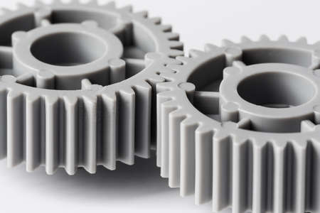 two plastic gears closeup geared for one another 스톡 콘텐츠