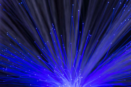 Abstract background of glowing blue color optical fibers Stock Photo