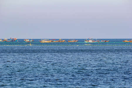 Fishing Vietnamese boats on the sea in a row