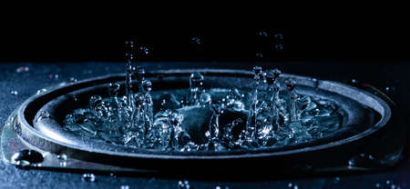 Water movement on the loudspeaker. The power of sound. Abstract movement. Loud music.