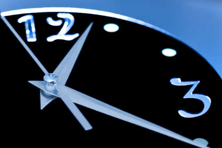 Part of the watch dial in backlight against a blue background