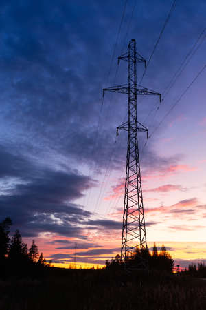Power line silhouette on colorful sunset background