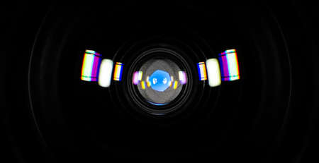 Six-blade aperture photographic lens with colored reflections, close-up