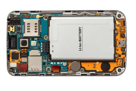 Disassembled mobile phone. Internal organization. Close-up, top view. Isolated on a white background.