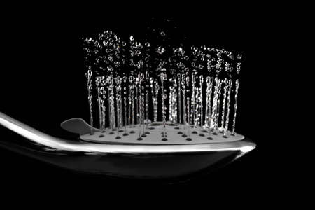 Water jets from the shower directed upwards. On a dark background.