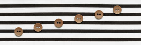 Buttons on the striped fabric in the form of a stave