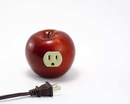 Electrified red apple with power cord.
