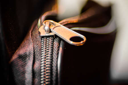 Close up of black leather bag zipper