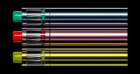 3 e-cigs of green red and yellow colours vaping devices on the black background Stock Photo