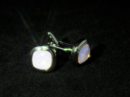 Cufflinks on a black background photo