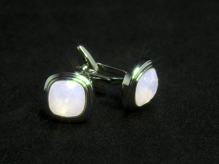 french cuffs: Cufflinks on a black background