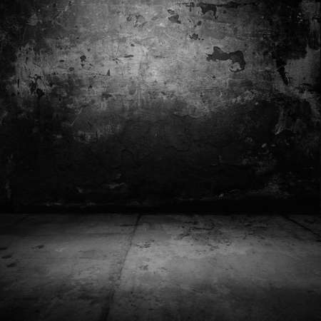 abandoned room: Background. Grunge wall in dark abandoned room.