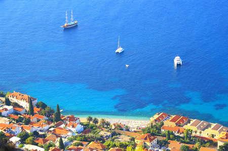 Beach, sea and touristic ships Stock Photo
