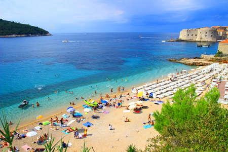 Tourists on beach Banje near Dubrovnik, famous touristic destination in Croatia