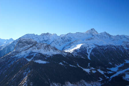 Winter landscape in Alps with Courmayeur ski resort
