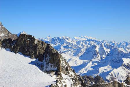 Winter landscape in Alps with Matterhorn an Monte Rosa peaks in background