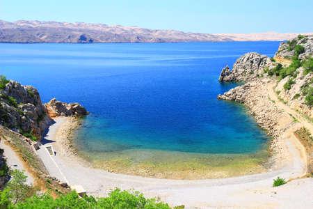 inlet bay: Sandy beach and blue sea in Karlobag, Croatia Stock Photo