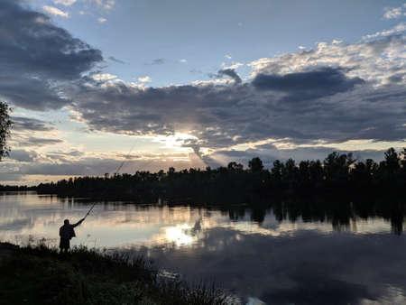 Fisherman at a sunset