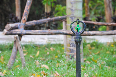 sprinkle system: sprinkler watering tool in garden