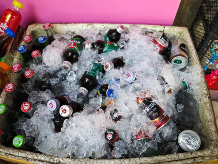 drinks, many of which are immersed in a foam box being covered by ices for sale in the market.