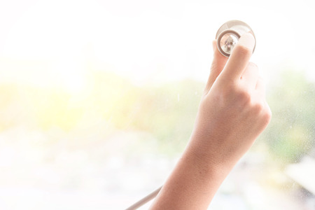 Woman hand with stethoscope medical health care na Natural remedies environment concept Reklamní fotografie