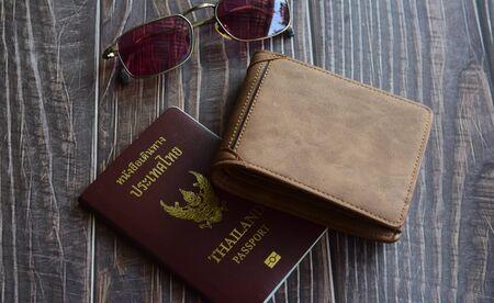 Preparation for travel, sunglasses, wallet, passport on wood floor vintage style Banque d'images