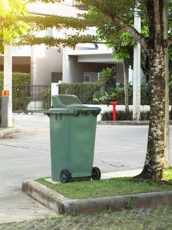 big bin: Large green trash bin for public park.