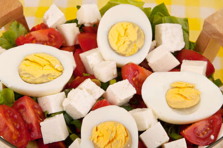 Closeup of a spring salad with eggs photo