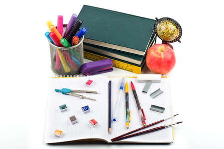 School supplies, books and apple on white background Stock Photo - 10446267