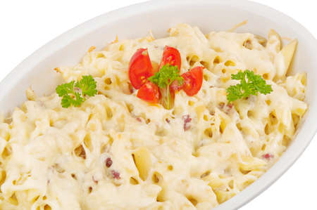 Baked pasta in a pan isolated on white background photo