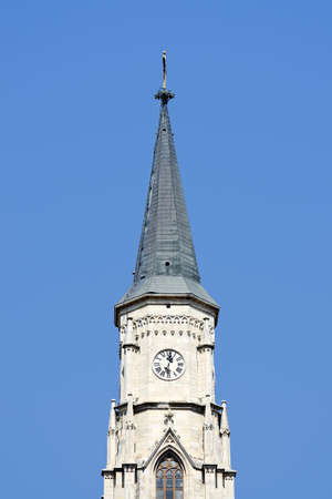 Church tower on blue sky photo