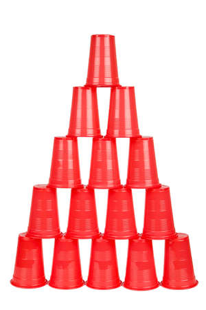Plastic red cups pyramid isolated on white background photo