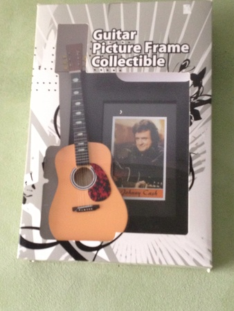 collectibles: Collectibles johnny cash photo frame with guitar  Stock Photo