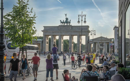Berlin, Germany - August 22, 2012: Many tourists and Berliners are on the Pariser Platz next to the Brandenburg Gate - one of the most famous places of Berlin Editorial
