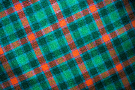 Photo of a pattern of checkered Scottish fabric for creating a background, pattern, textiles, printed matter
