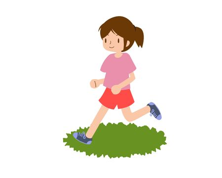 A young woman running with a smile on the grass