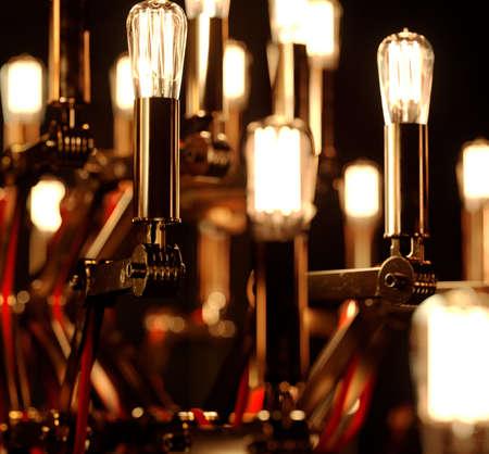 Beautiful decorative chandelier with illuminating light bulbs, Christmas celebrations, Christmas lights