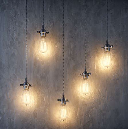 Beautiful Decorative illuminating light bulbs hanging on wires , wall backgrounds