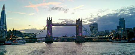 river thames: Tower Bridge at night from the river Thames Stock Photo
